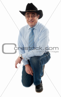Smiling man wearing cowboy hat