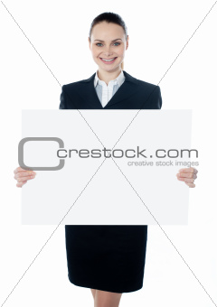 Businesswoman holding a blank white poster
