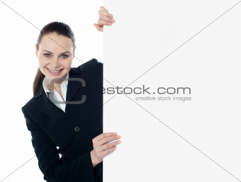 Businesswoman holding a long banner ad