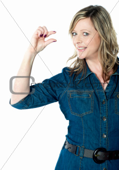 Portrait of beautiful woman gesturing small bit