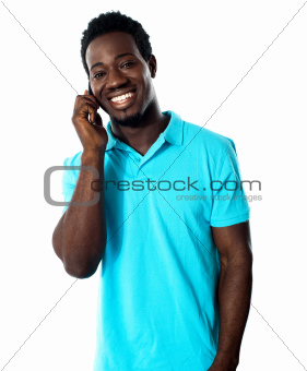 Casual young man communicating on phone