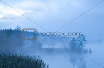 Barmsee and mounrains in morning fog