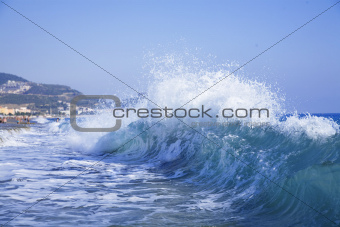 foamy big blue waves in a clear summer day
