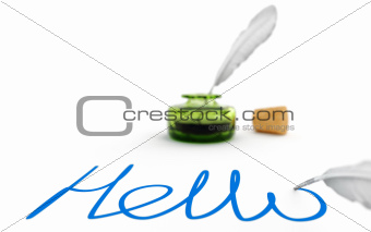 Feather quill, inkwell and text on white background
