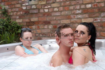 Three people in a jacuzzi