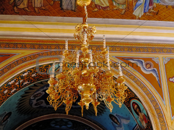Gold ornated luxurious luster in interior of church
