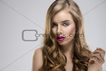 girl with flowing hair portrait turned of three quarters