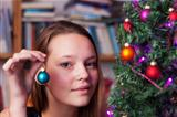 young woman decorating for christmas