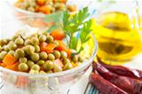 Salad with canned green peas and boiled carrots