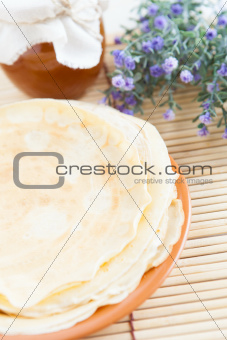 Pancakes with honey on a plate