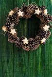 Cone wreath decoration with bread stars