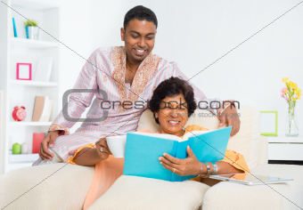 Indian family reading a book