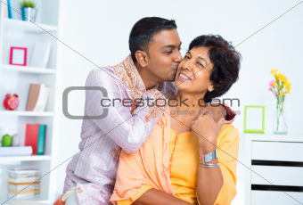 Indian male kissing his mother