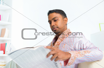 Indian male reading news paper