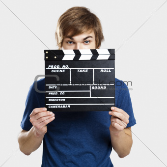 Showing a clapboard