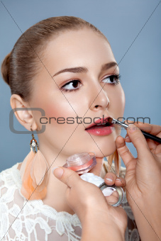 Close up Young Beautiful Woman with Brush for Professional Make-up