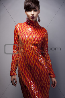 Fashion Style - Luxurious Woman in Red Dress with Strass posing