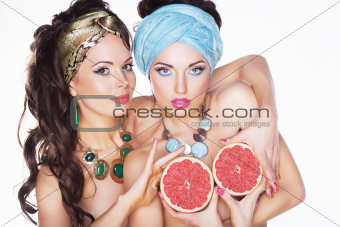 Women holding Grapefruits in hands - Diet and Nutrition concept