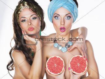 Humorous Fancy Women holding Grapefruit - Performance