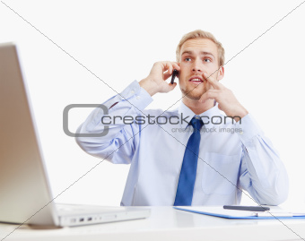 young man at office talking on mobile phone