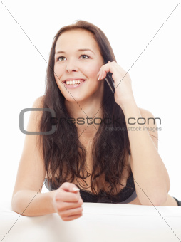 young girl talking on her mobile phone smiling