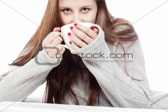 young woman with brown hair drinking cup of coffee