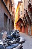motorbike parking on Bologna old narrow street