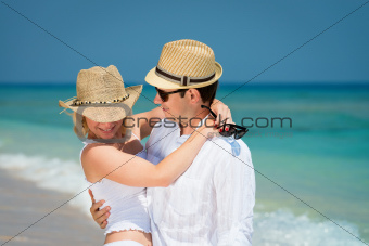 Loving couple in honeymoon on tropical resort