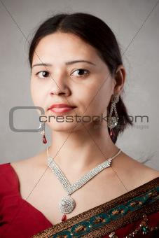 Beautiful Indian happy woman in red sari