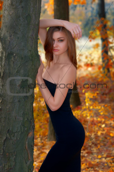 hot young woman in autumn park