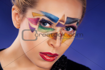 portrait of beautiful girl with triangles on the face