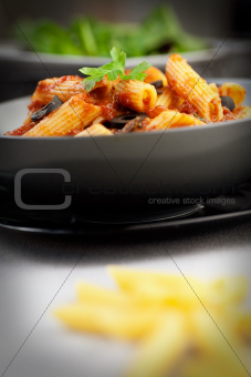 Pasta with tomato and olives