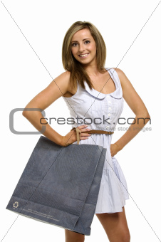 Woman in a cute dress holding a shopping bag