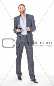 Full length portrait of cheerful business man with glass wine