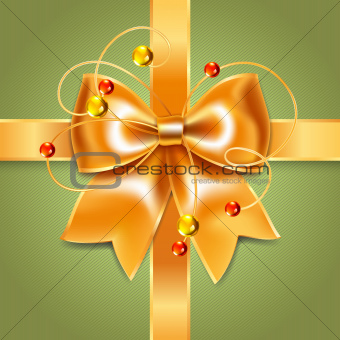 Gold bow of silk ribbon. Perfect as invitation or congratulation.