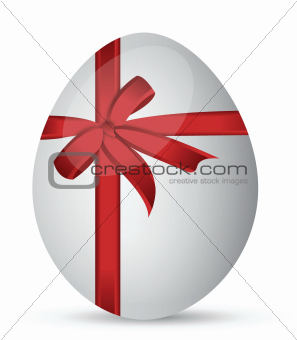 egg with a red ribbon