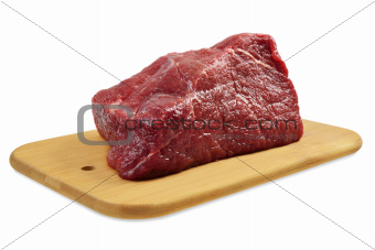Beef on a wooden board