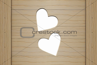 Two hearts in a wooden board