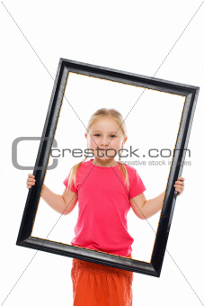 Little girl in wooden frame.