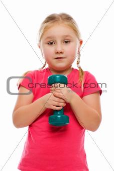Little girl with dumbbell.