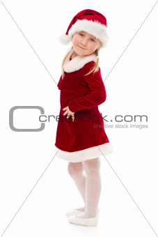 Little girl in Santa costume.