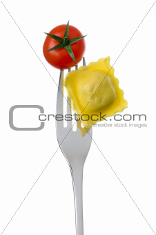 ravioli and tomato on a fork against a white background