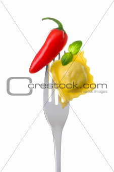 ravioli basil and chili pepper on a fork
