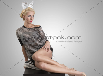 sexy girl with silver bunny ears in sensual pose
