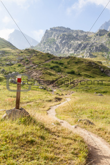 Path sign on Italian Alps