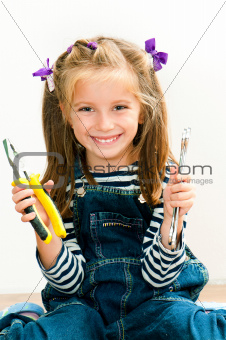 smiling girl with pliers and wrench
