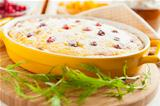 Cheese gratin with cranberries and raisins