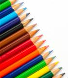 Colored Pencils in a Row on White