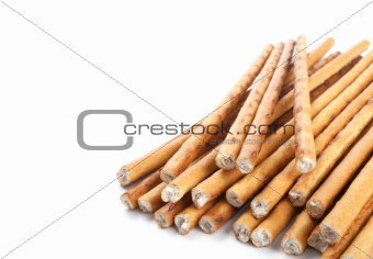 crispy sticks on white background