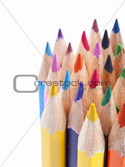 Various colour pencils in close up on white